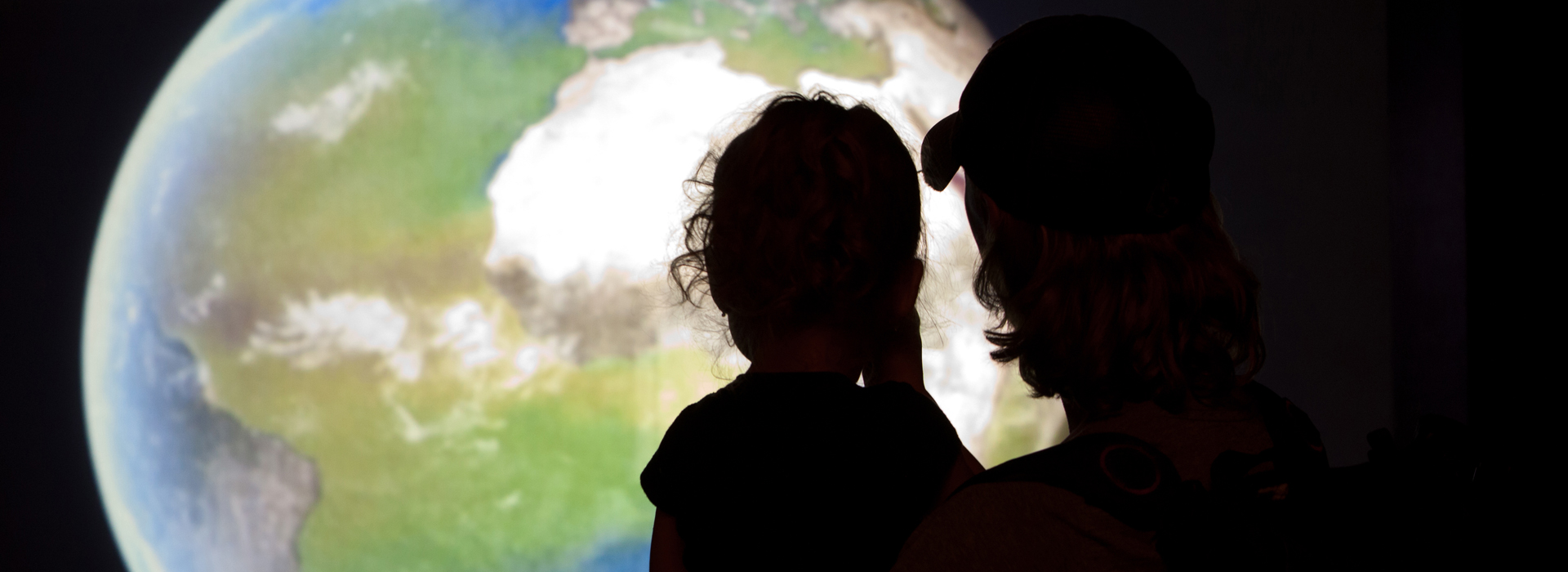 Parent and Child observe NASA display exhibit at the Arizona-Sonora Desert Museum